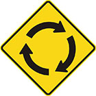 yellow diamond-shaped sign with three black arrows creating a circle, pointing in a clockwise direction