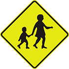 yellow diamond-shaped sign with a black symbol of an older child holding a child's hand