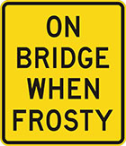 yellow sign with black text, on bridge when frosty