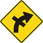 yellow diamond-shaped sign with black arrow that curves steadily right with a straight line crossing the tail in the middle
