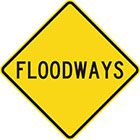yellow diamond-shaped sign with black text, floodways