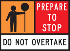 A traffic controller roadworks sign with prepare to stop sign.