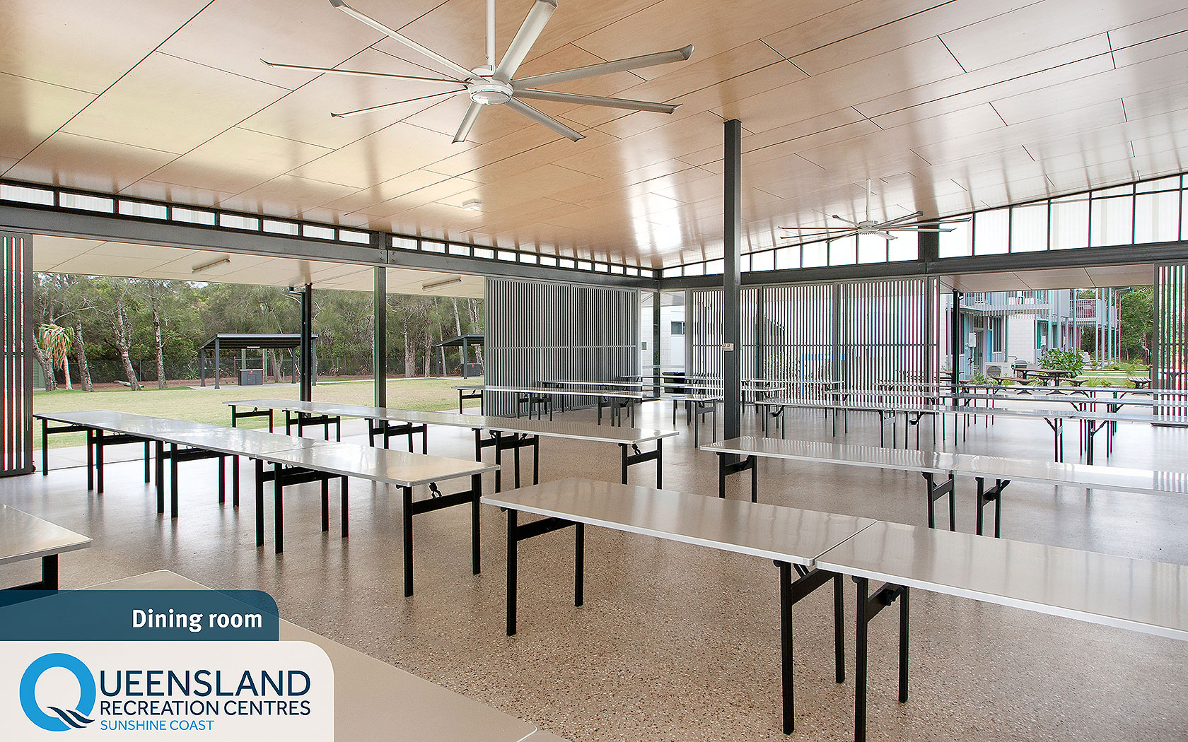 Spacious open dining area with group tables and fans at the Sunshine Coast Recreation Centre