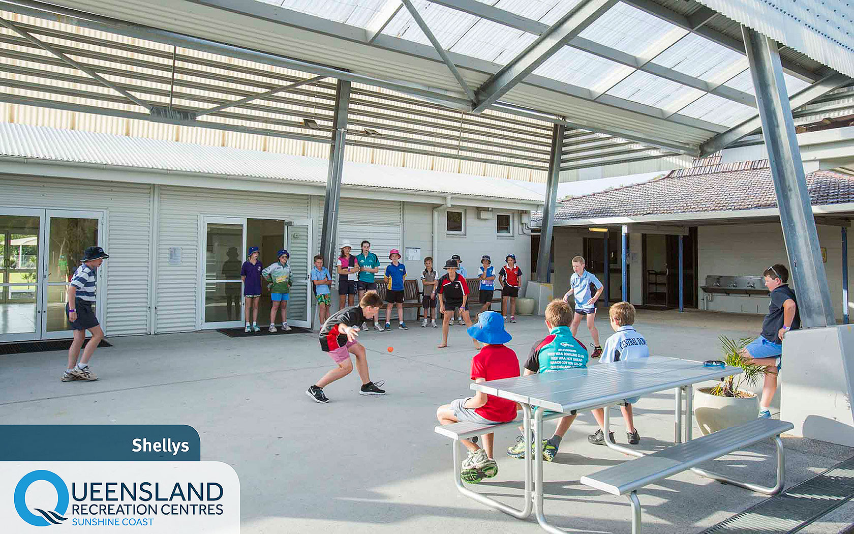 Children playing handball in the covered group meeting area outside Shelly's accommodation at the Sunshine Coast Recreation Centre