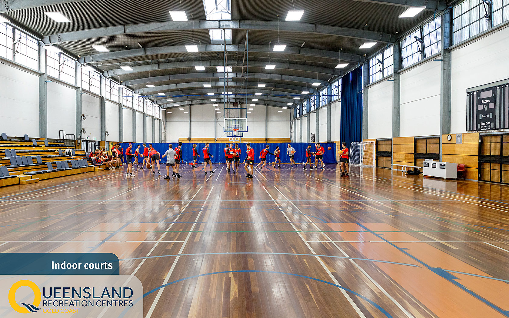 Sporting team playing basketball on wooden-floored indoor courts at the Gold Coast Recreation Centre