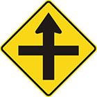 yellow diamond-shaped sign with straight black arrow with another straight line crossing it at right angles
