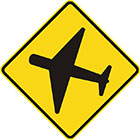 yellow diamond-shaped sign with black icon of an aeroplane