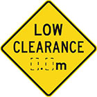 yellow diamond-shaped sign with black text, low clearance, and space for measurement
