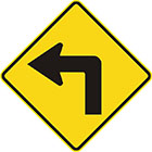 yellow diamond-shaped sign with black arrow that bends to the left at a right angle