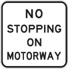white sign with black text, no stopping on motorway