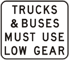 Example black text on white sign: Trucks & buses must use low gear