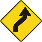 yellow diamond-shaped sign with black arrow with tail kinked about 45 degrees right then left