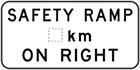 white sign with black text, safety ramp, space for distance, on right