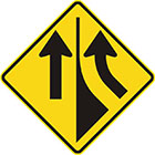 yellow diamond-shaped sign with a black arrow entering from the right and curving upward and another pointing upward with a divider between them
