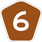 brown pentagonal sign with the number 6