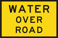 Image of a temporary sign that indicates there is water over a road ahead