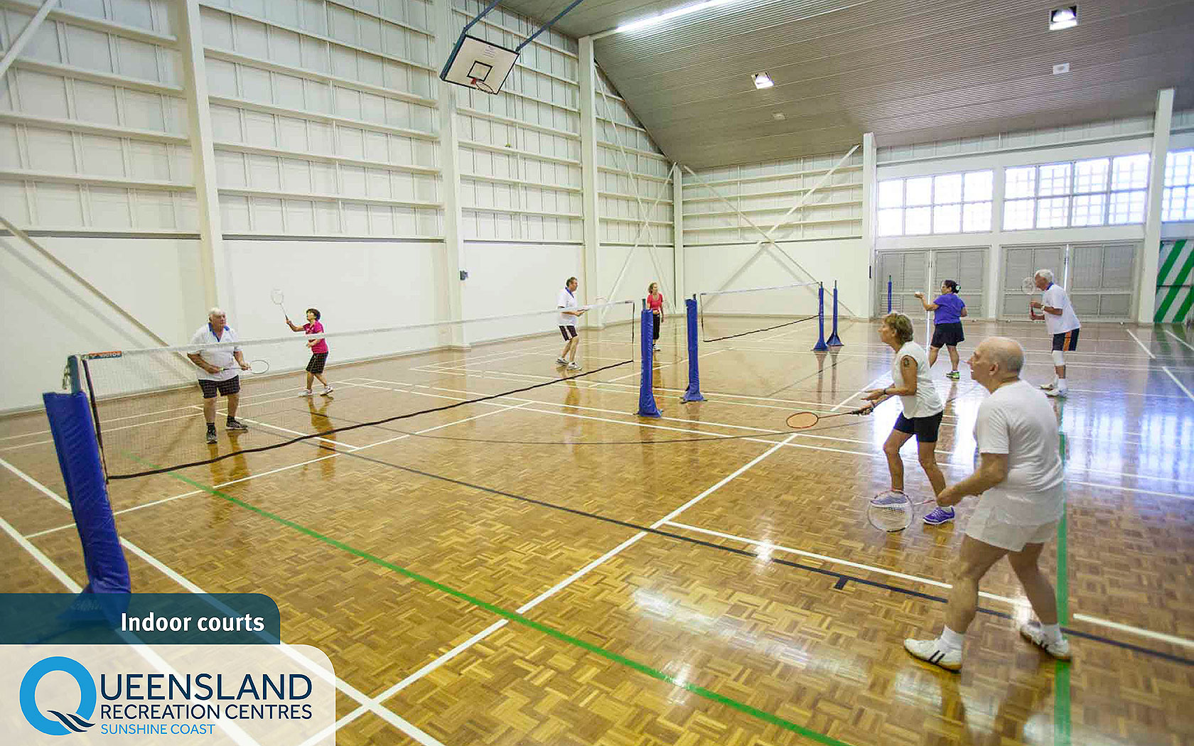 Visitors playing badminton in the indoor courts of the Sunshine Coast Recreation Centre