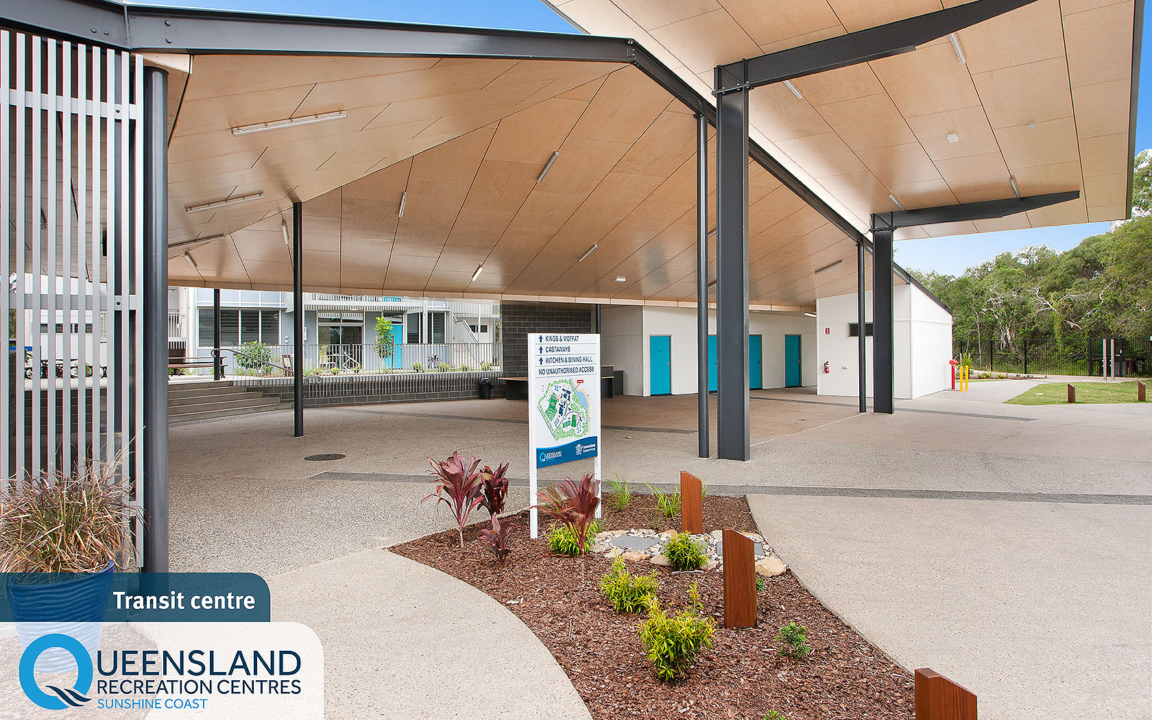 Spacious covered bus drop off area with bathrooms and map of the Sunshine Coast Recreation Centre