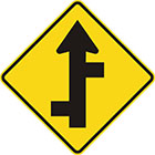 yellow diamond-shaped sign with straight black arrow with alternating branches off each side of the tail