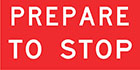 red sign with white text, prepare to stop