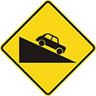 yellow diamond-shaped sign with black car facing down a slope