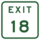 white sign with green text, exit 18