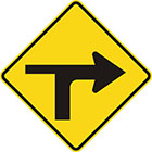yellow diamond-shaped sign with black arrow that curves sharply right with a thinner line branching to the left