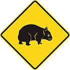 yellow diamond-shaped sign with black wombat icon