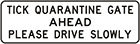 white sign with black text, tick quarantine gate ahead, please drive slowly