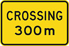 yellow sign with black text, crossing 300m