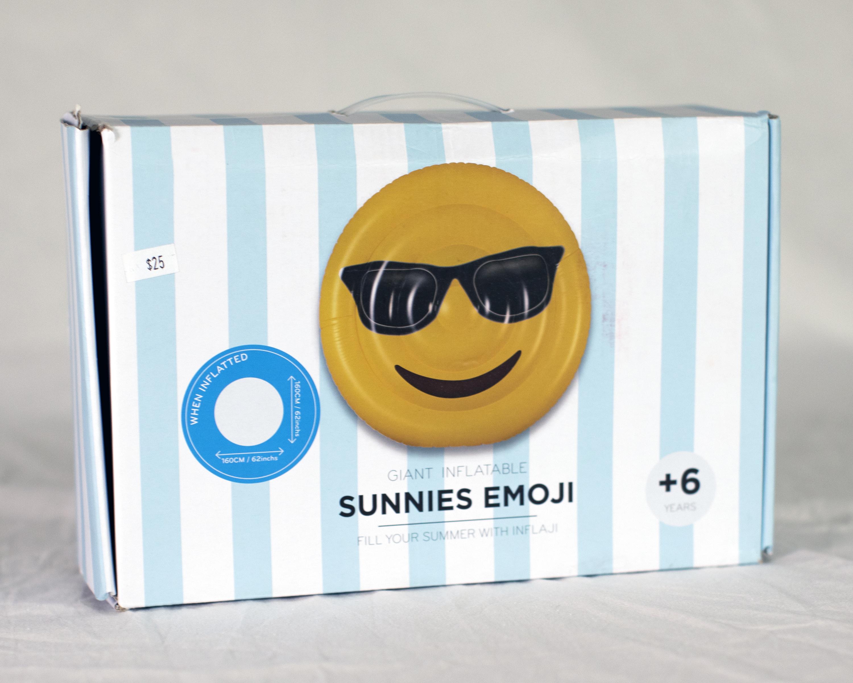 Round yellow inflatable emoji wearing sunnies