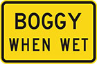 yellow sign with black text, boggy when wet