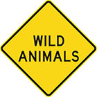yellow diamond-shaped sign with black text, wild animals