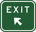 green sign with white arrow and the word exit