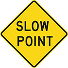 yellow diamond-shaped sign with black text, slow point