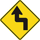 yellow diamond-shaped sign with black arrow that has tail bent at right angles left then right