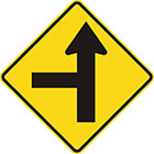 yellow diamond-shaped sign with straight black arrow with a straight branch leaving it at a right angle on the left