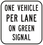 white sign with black text, one vehicle per lane on green signal