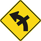 yellow diamond-shaped sign with black arrow that curves steadily left with a straight line crossing the tail in the middle