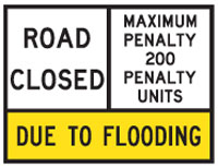 Image of a restricted road use sign that closes the roads because of flooding.