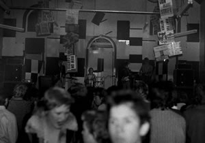 Photo of bands and the crowd inside Baroona Hall from 4 July 1980