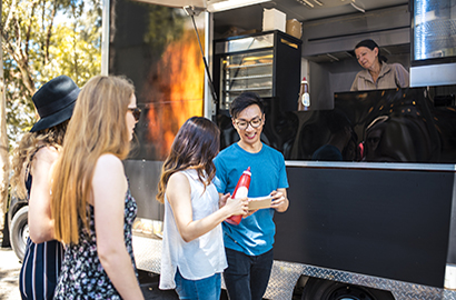 Youth ordering food from a food truck