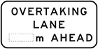 white sign with black text, overtaking lane, space for distance, ahead