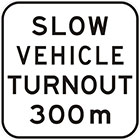 white sign with black text, slow vehicle turnout 300m