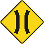 yellow diamond-shaped sign with 2 parallel black lines that veer toward each other slightly and then away again