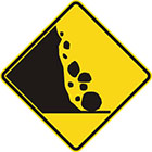 yellow diamond-shaped sign with black icon of rocks rolling down a rockface