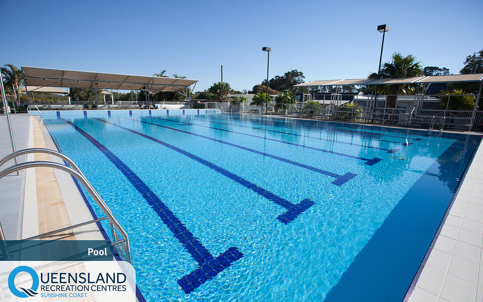 Outdoor heated pool with shade cloths and spectating stands at the Sunshine Coast Recreation Centre
