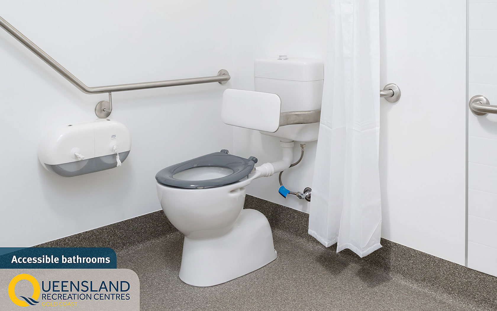 Accessible cabin bathroom with hand rails and accessible dispensers at the Gold Coast Recreation Centre