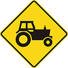 yellow diamond-shaped sign with black tractor icon