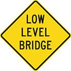 yellow diamond-shaped sign with black text, low level bridge